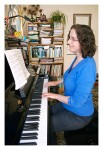Jane playing the piano in her Studio