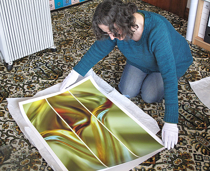 Jane inspecting an A1 sized Limited Edition Print of 'Tulip' before couriering it to one of her customers